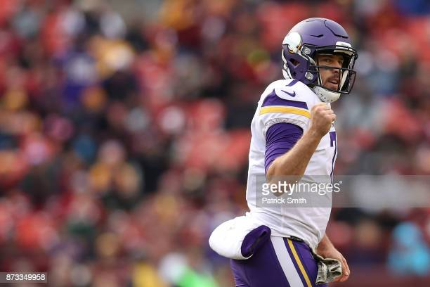 Quarterback Case Keenum of the Minnesota Vikings celebrates after scoring a touchdown during the third quarter against the Washington Redskins at...
