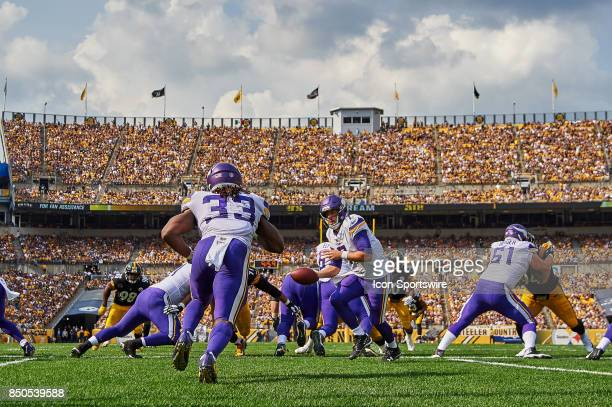 Quarterback Case Keenum of the Minnesota Vikings gets ready to hand the football to Minnesota Vikings running back Ronnie Hillman during an NFL...