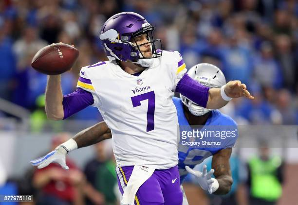 Quarterback Case Keenum of the Minnesota Vikings looks down field to pass the ball against the Detroit Lions during the second halfat Ford Field on...