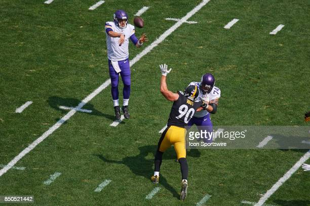 Quarterback Case Keenum of the Minnesota Vikings looks to throw the football over outside linebacker TJ Watt of the Pittsburgh Steelers during an NFL...