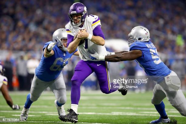 Quarterback Case Keenum of the Minnesota Vikings runs with the ball against Anthony Zettel of the Detroit Lions and Tahir Whitehead for a touchdown...