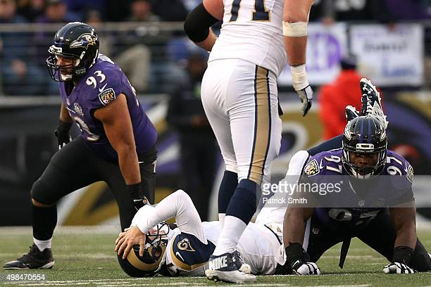 Quarterback Case Keenum of the St Louis Rams holds his head after taking a hit against the Baltimore Ravens in the fourth quarter at MT Bank Stadium...