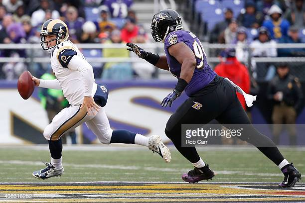 Quarterback Case Keenum of the St Louis Rams scrambles under pressure from defensive end Chris Canty of the Baltimore Ravens in the second quarter at...