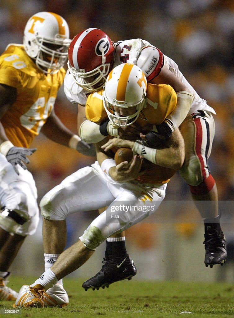 Quarterback Casey Clausen of the Tennessee Volunteers is sacked by David Pollack of the Georgia Bulldogs in the second half on October 11 2003 at...