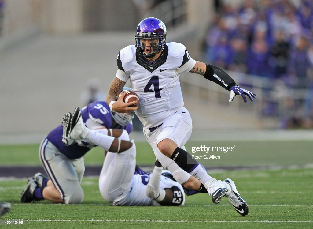 Quarterback <a gi-track='captionPersonalityLinkClicked' href=/galleries/search?phrase=Casey+Pachall&family=editorial&specificpeople=6523207 ng-click='$event.stopPropagation()'>Casey Pachall</a> #4 of the TCU Horned Frogs rushes up field against the Kansas State Wildcats during the second half on November 16, 2013 at Bill Snyder Family Stadium in Manhattan, Kansas. Kansas State defeated TCU