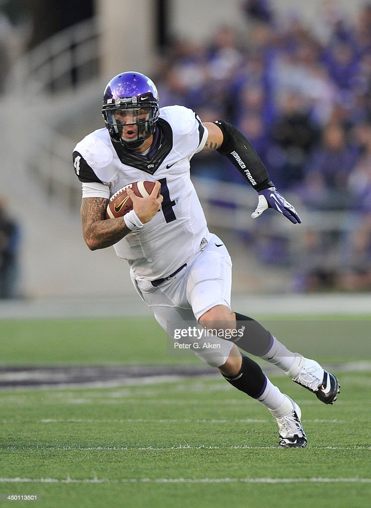 Quarterback <a gi-track='captionPersonalityLinkClicked' href=/galleries/search?phrase=Casey+Pachall&family=editorial&specificpeople=6523207 ng-click='$event.stopPropagation()'>Casey Pachall</a> #4 of the TCU Horned Frogs rushes up field against the Kansas State Wildcats during the second half on November 16, 2013 at Bill Snyder Family Stadium in Manhattan, Kansas. Kansas State defeated TCU 33-31.