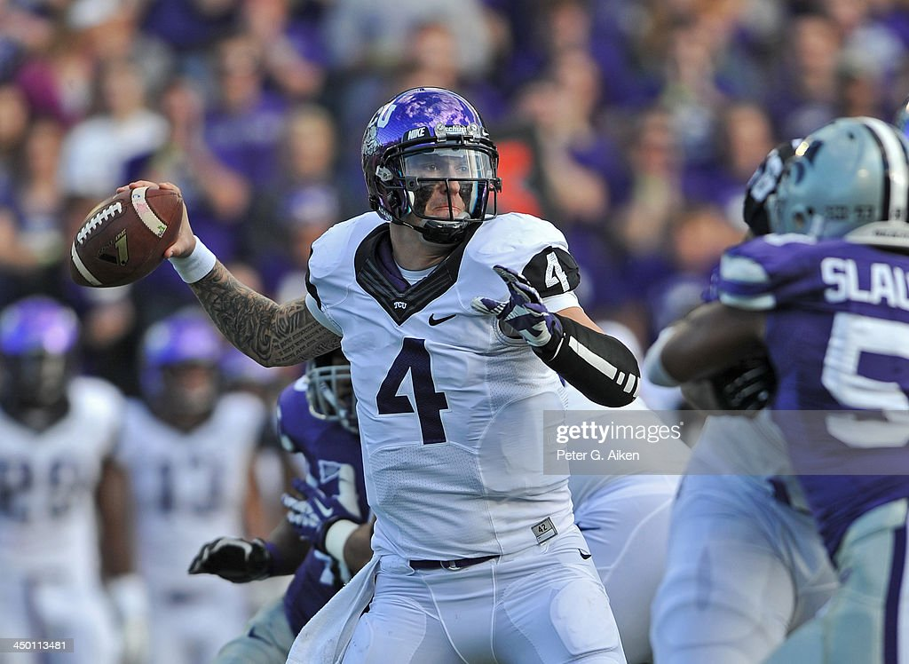 Quarterback <a gi-track='captionPersonalityLinkClicked' href=/galleries/search?phrase=Casey+Pachall&family=editorial&specificpeople=6523207 ng-click='$event.stopPropagation()'>Casey Pachall</a> #4 of the TCU Horned Frogs throws a pass down field against the Kansas State Wildcats during the first half on November 16, 2013 at Bill Snyder Family Stadium in Manhattan, Kansas. Kansas State defeated TCU
