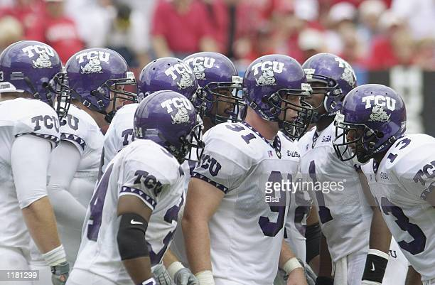 Quarterback Casey Printers of the Texas Christian University Horned Frogs leads the offensive huddle during the NCAA football game against the...