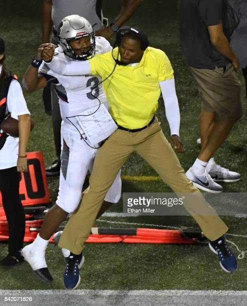 Quarterback Caylin Newton of the Howard Bison celebrates with wide receivers coach Mike London Jr after Newton scored a fouryard rushing touchdown...