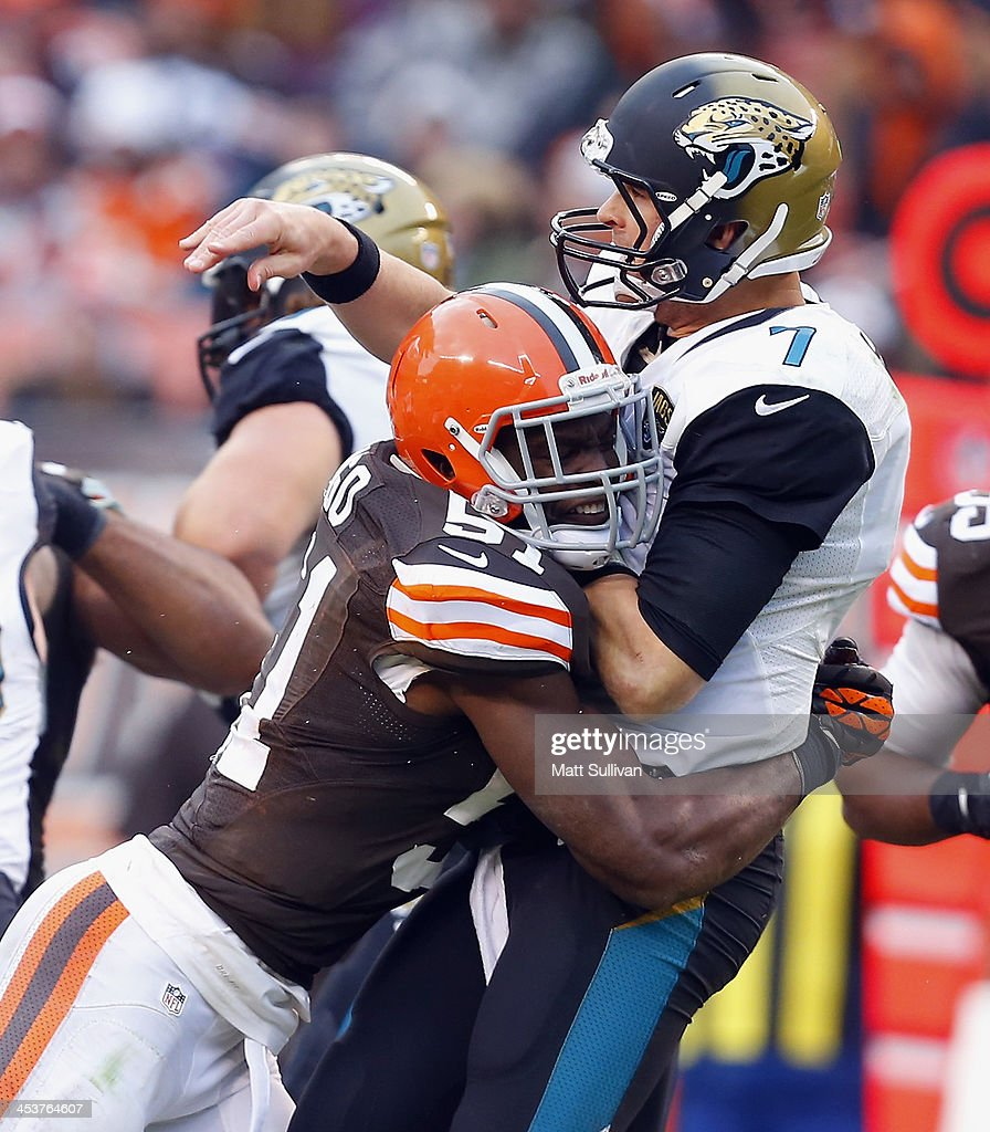 Quarterback Chad Henne of the Jacksonville Jaguars is hit by linebacker Barkevious Mingo of the Cleveland Browns at FirstEnergy Stadium on December 1...