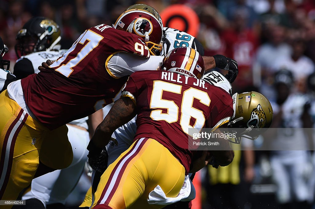 Quarterback Chad Henne of the Jacksonville Jaguars is sacked by inside linebacker Perry Riley of the Washington Redskins at FedExField on September...