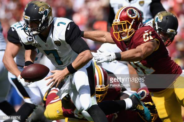 Quarterback Chad Henne of the Jacksonville Jaguars is sacked by outside linebacker Ryan Kerrigan of the Washington Redskins during the second half at...