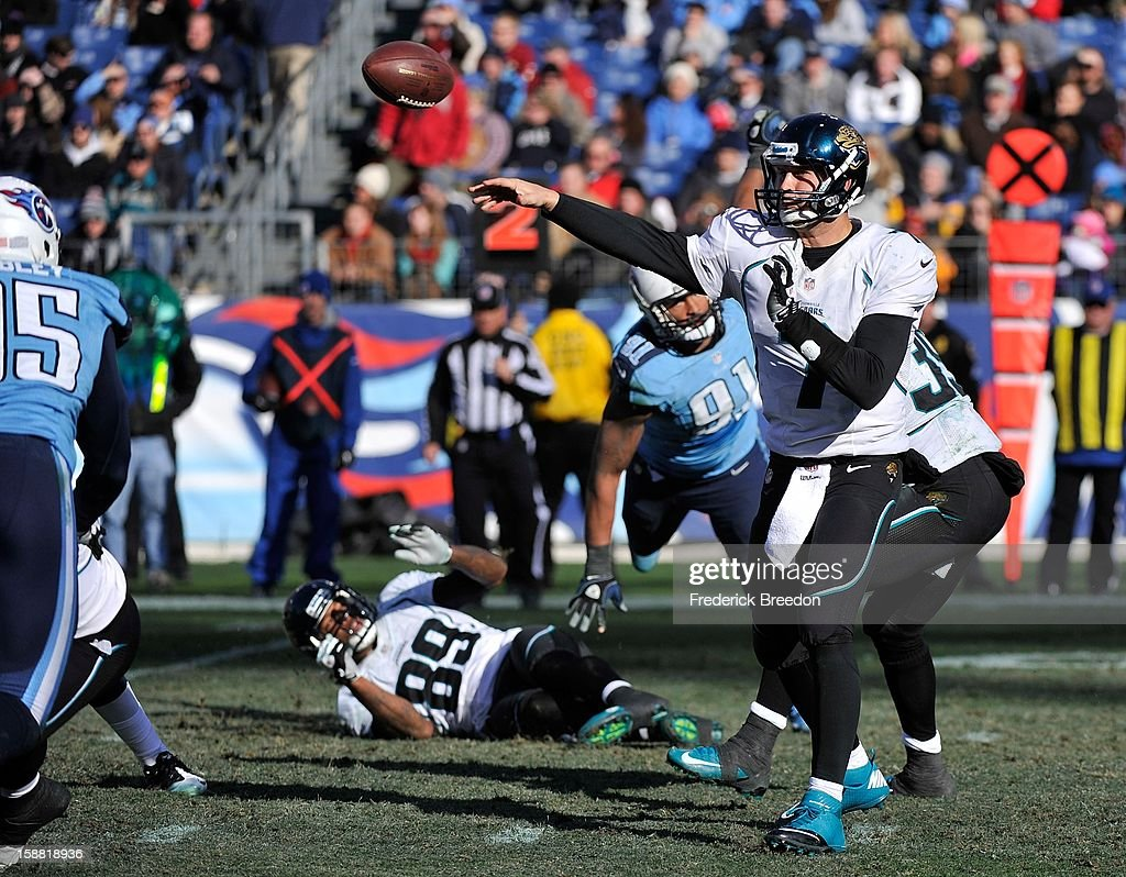 Quarterback <a gi-track='captionPersonalityLinkClicked' href=/galleries/search?phrase=Chad+Henne&family=editorial&specificpeople=216361 ng-click='$event.stopPropagation()'>Chad Henne</a> #7 of the Jacksonville Jaguars throws an interception against the Tennessee Titans at LP Field on December 30, 2012 in Nashville, Tennessee.