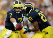 Quarterback Chad Henne of the Michigan Wolverines passes to Mike Hart during the first half of the game against the USC Trojans on January 1 2007 at...