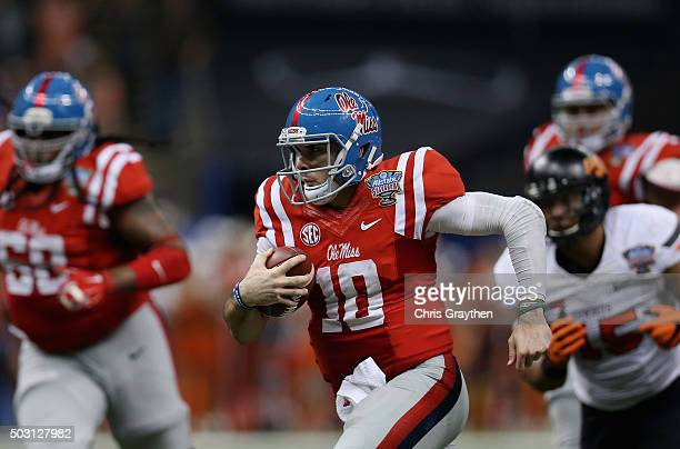 Quarterback Chad Kelly of the Mississippi Rebels carries the ball against the Oklahoma State Cowboys during the second quarter of the Allstate Sugar...