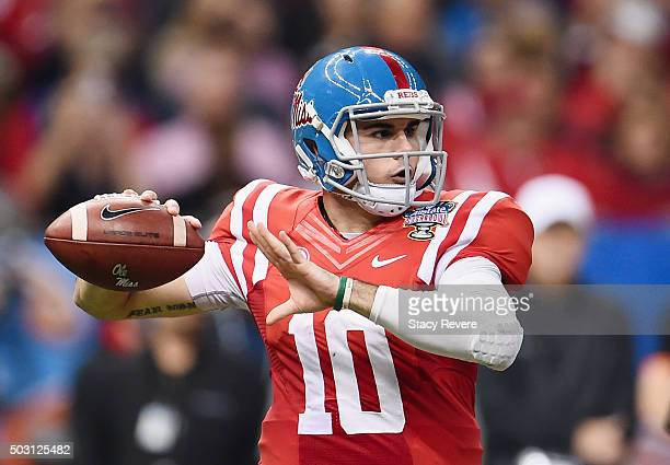 Quarterback Chad Kelly of the Mississippi Rebels drops back to pass against the Oklahoma State Cowboys during the second quarter of the Allstate...