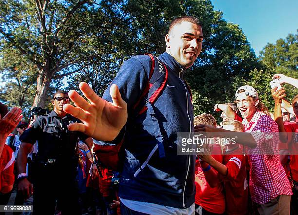 Quarterback Chad Kelly of the Mississippi Rebels greets fans as they walk down Walk of Champions in the Grove before an NCAA college football game...
