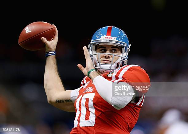 Quarterback Chad Kelly of the Mississippi Rebels looks to throw a pass during warmups before playing against the Oklahoma State Cowboys during the...