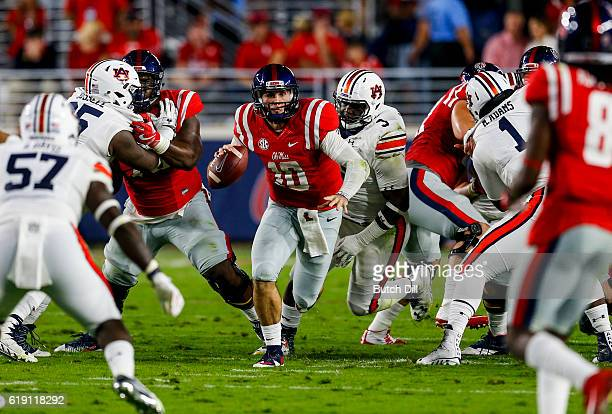 Quarterback Chad Kelly of the Mississippi Rebels scrambles for yardage during the first half of an NCAA college football game against the Auburn...