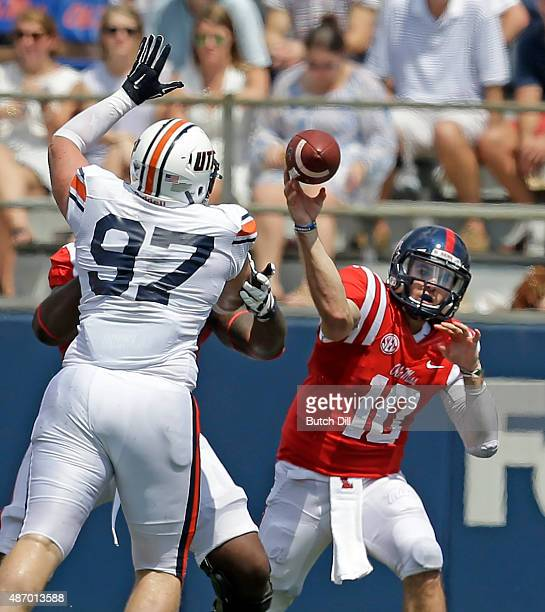 Quarterback Chad Kelly of the Mississippi Rebels throws a pass during the second quarter of a NCAA college football game against the Tennessee Martin...