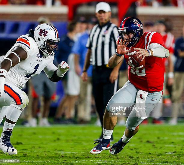 Quarterback Chad Kelly of the Mississippi Rebels tries to get past defensive tackle Montravius Adams of the Auburn Tigers as he scrambles for yardage...