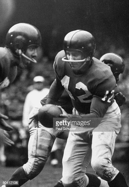 Quarterback Charles Conerly handing ball to Alex Webster who picks up nine yards
