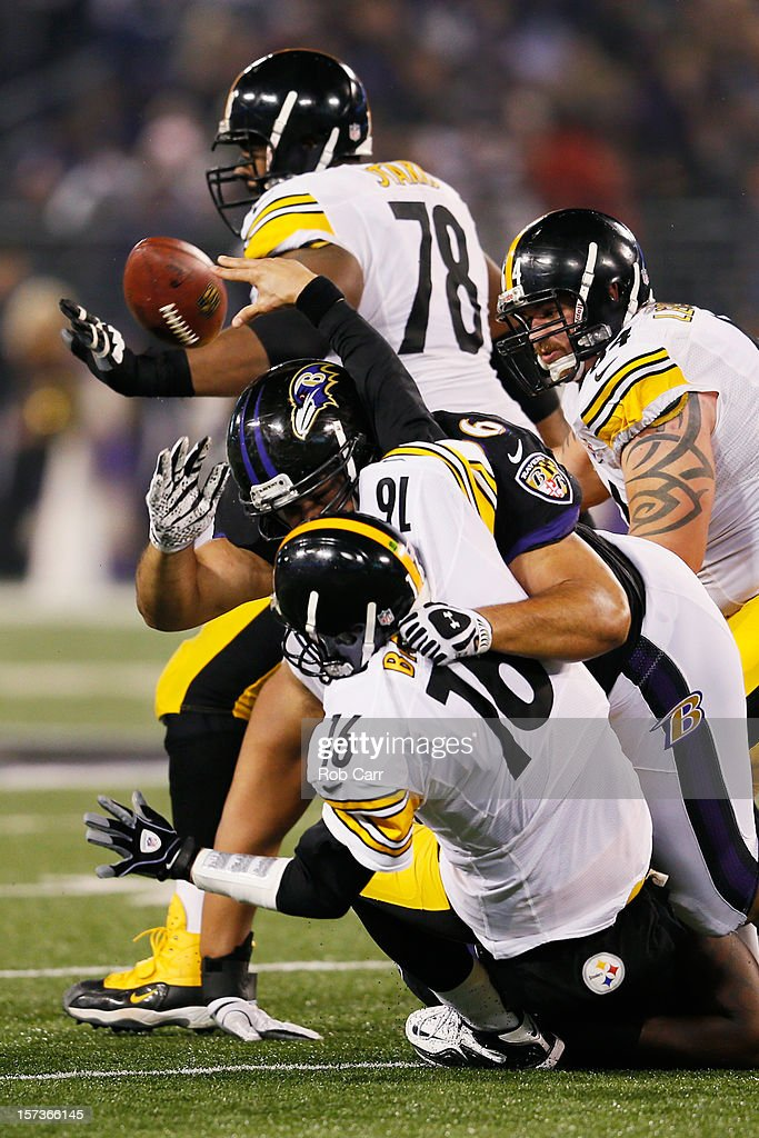 Quarterback Charlie Batch of the Pittsburgh Steelers is hit by nose tackle Ma'ake Kemoeatu of the Baltimore Ravens while throwing a third quarter...