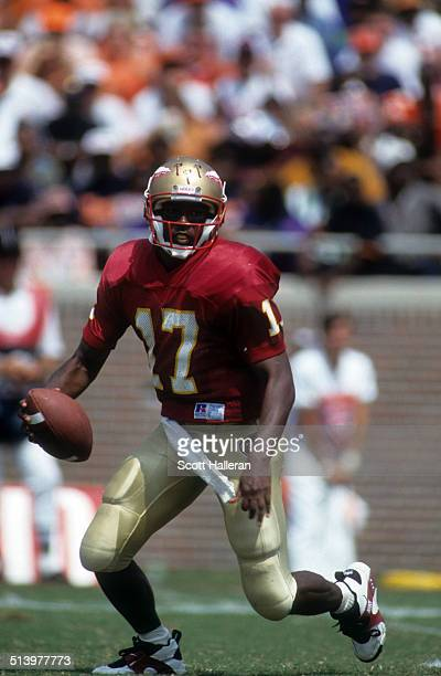 Quarterback Charlie Ward of the Florida State Seminoles looks to run the ball during an NCAA game against the Clemson Tigers on September 11 1993 at...