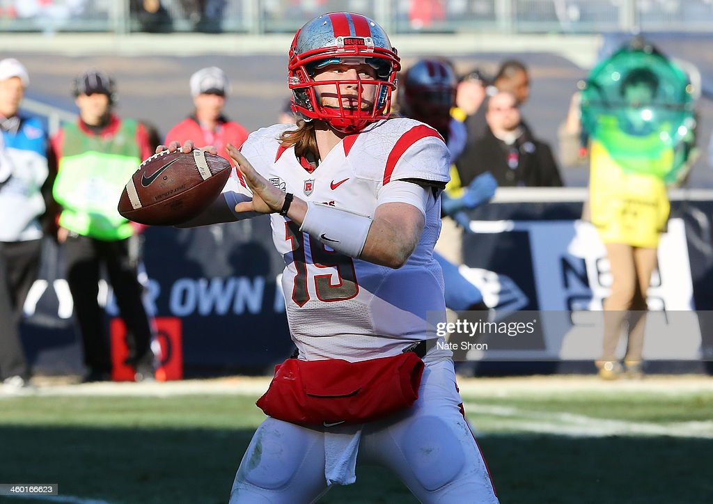 Quarterback Chas Dodd #19 of the Rutgers Scarlet Knights prepares to throw the ball against the Notre Dame Fighting Irish during the New Era Pinstripe Bowl at Yankee Stadium on December 28, 2013 in the Bronx Borough of New York City.
