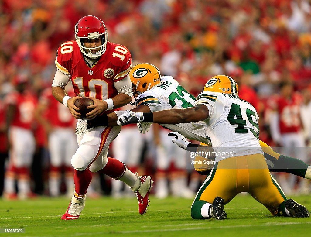 Quarterback Chase Daniel #10 of the Kansas City Chiefs is sacked by linebacker Rob Francois #49 of the Green Bay Packers during the preseason game on at Arrowhead Stadium on August 29, 2013 in Kansas City, Missouri.