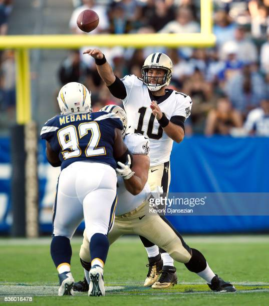 Quarterback Chase Daniel of the New Orleans Saints throws a pass against the Los Angeles Chargers during the first half of their preseason football...