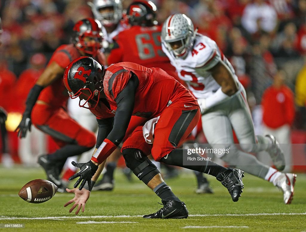 Quarterback Chris Laviano #5 of the Rutgers Scarlet Knights scoops up the ball after a bad snap from center against the Ohio State Buckeyes during the second quarter at High Point Solutions Stadium on October 24, 2015 in Piscataway, New Jersey. Ohio State defeated Rutgers 49-7.