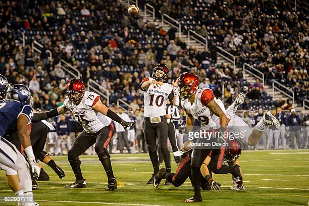Quarterback Christian Chapman of San Diego throws the ball for a touchdown against Nevada tonight at Mackay Stadium on November 12 2016 in Reno Nevada