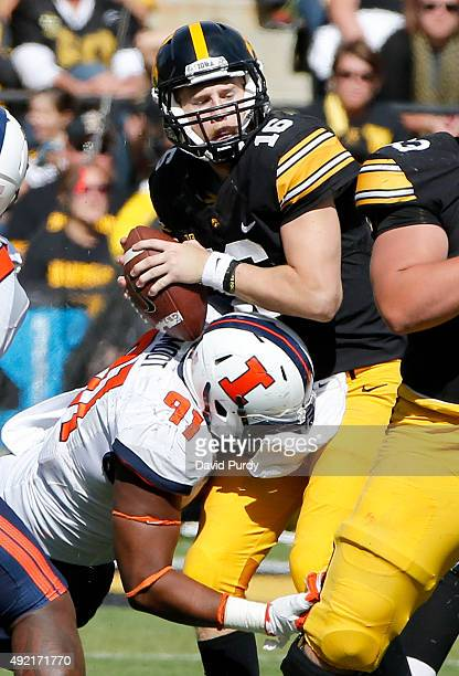 Quarterback CJ Beathard of the Iowa Hawkeyes is sacked by linebacker Dawuane Smoot of the Illinois Fighting Illini in the second half of play at...