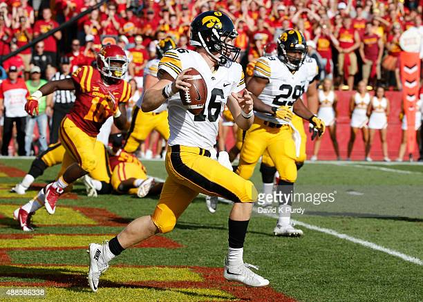 Quarterback CJ Beathard of the Iowa Hawkeyes scrambles for yards in the first half of play against the Iowa State Cyclones at Jack Trice Stadium on...