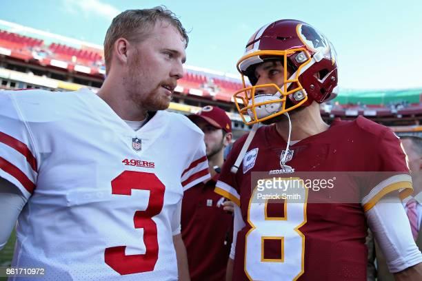 Quarterback CJ Beathard of the San Francisco 49ers and quarterback Kirk Cousins of the Washington Redskins talk after the Washington Redskins...