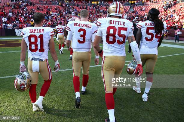 Quarterback CJ Beathard of the San Francisco 49ers and teammates walk of the field after losing 2624 to the Washington Redskins at FedExField on...