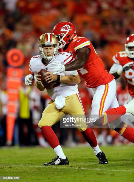 Quarterback CJ Beathard of the San Francisco 49ers is sacked by linebacker Earl Okine of the Kansas City Chiefs during the preseason game at...