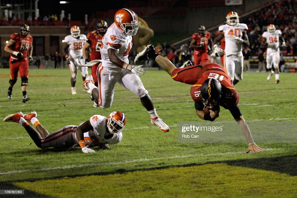 Quarterback CJ Brown of the Maryland Terrapins dives into the endzone for a touchdown in front of the Clemson Tigers defense during the first half at...
