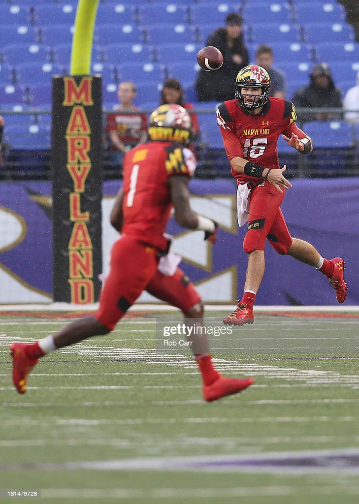 Quarterback C.J. Brown #16 of the Maryland Terrapins throws a pass to wide receiver <a gi-track='captionPersonalityLinkClicked' href=/galleries/search?phrase=Stefon+Diggs&family=editorial&specificpeople=6786164 ng-click='$event.stopPropagation()'>Stefon Diggs</a> #1 against the West Virginia Mountaineers durng the fourth quarter at M&T Bank Stadium on September 21, 2013 in Baltimore, Maryland.