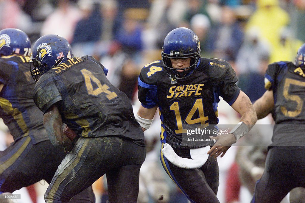 Quarterback Clint Carlson of the San Jose State Spartans moves around his tailback Jarmar Julien during the NCAA game against the Stanford Cardinal...