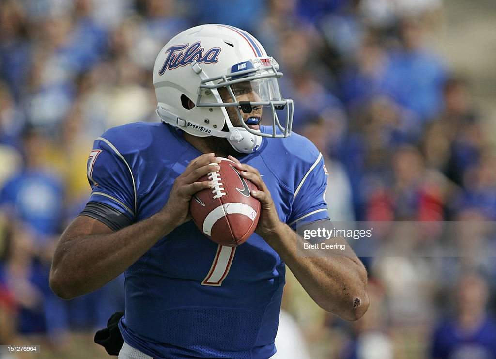 Quarterback <a gi-track='captionPersonalityLinkClicked' href=/galleries/search?phrase=Cody+Green&family=editorial&specificpeople=5370288 ng-click='$event.stopPropagation()'>Cody Green</a> #7 of the Tulsa Golden Hurricane looks to throw against the Central Florida Knights during the C-USA championship game on December 1, 2012 at H.A. Chapman Stadium in Tulsa, Oklahoma. Tulsa defeated Central Florida 33-27 in overtime.
