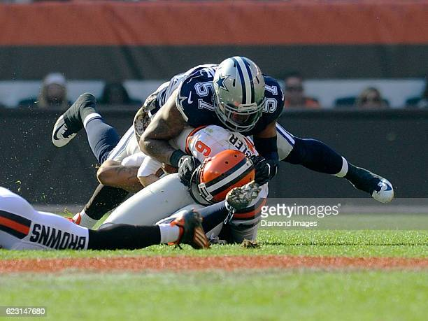 Quarterback Cody Kessler of the Cleveland Browns is sacked by linebacker Damien Wilson of the Dallas Cowboys during a game on November 6 2016 at...