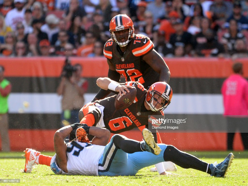 Quarterback Cody Kessler #6 of the Cleveland Browns is sacked by linebacker Derrick Morgan #91 of the Tennssee Titans in the fourth quarter of a game on October 22, 2017 at FirstEnergy Stadium in Cleveland, Ohio. Tennessee won 12-9 in overtime.