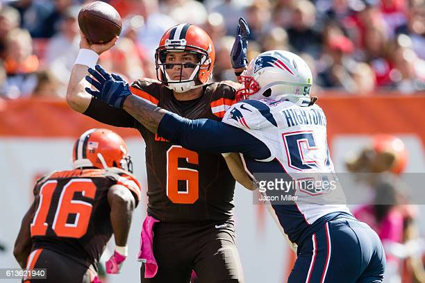 Quarterback Cody Kessler of the Cleveland Browns is tackled by middle linebacker Dont'a Hightower of the New England Patriots as he throws a...