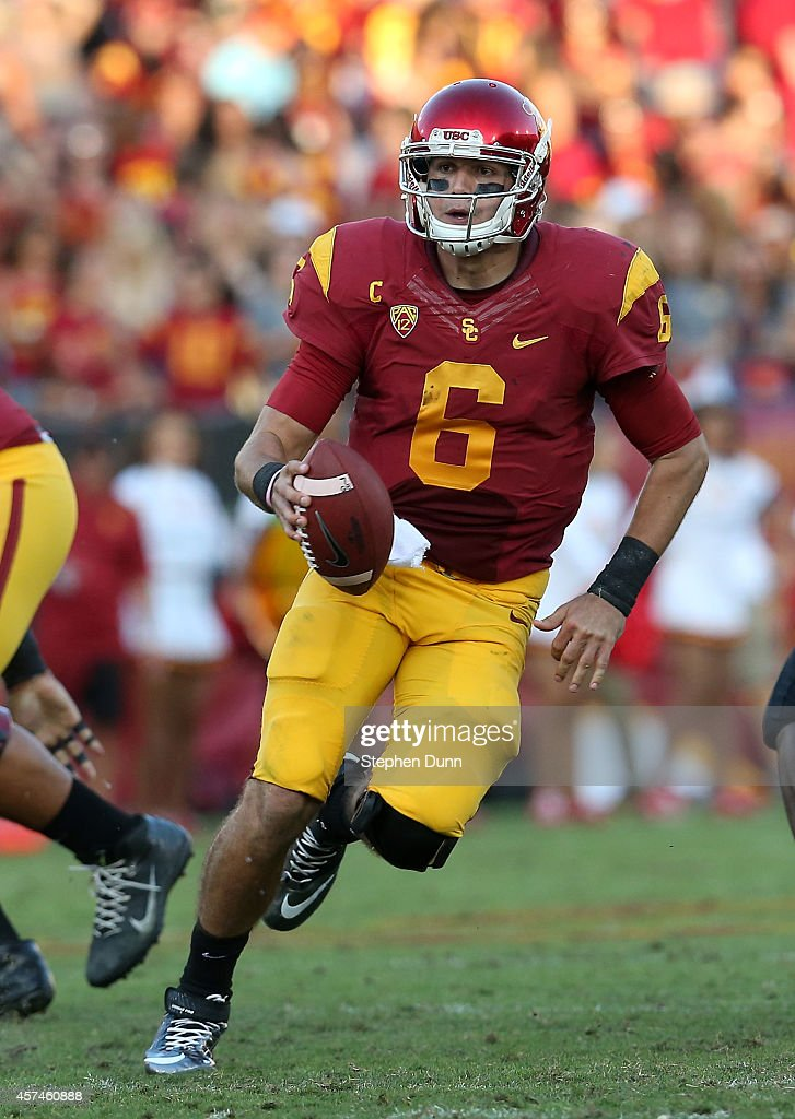 Quarterback <a gi-track='captionPersonalityLinkClicked' href=/galleries/search?phrase=Cody+Kessler&family=editorial&specificpeople=9870723 ng-click='$event.stopPropagation()'>Cody Kessler</a> #6 of the USC Trojans runs with the ball against the Colorado Buffaloes at Los Angeles Memorial Coliseum on October 18, 2014 in Los Angeles, California.