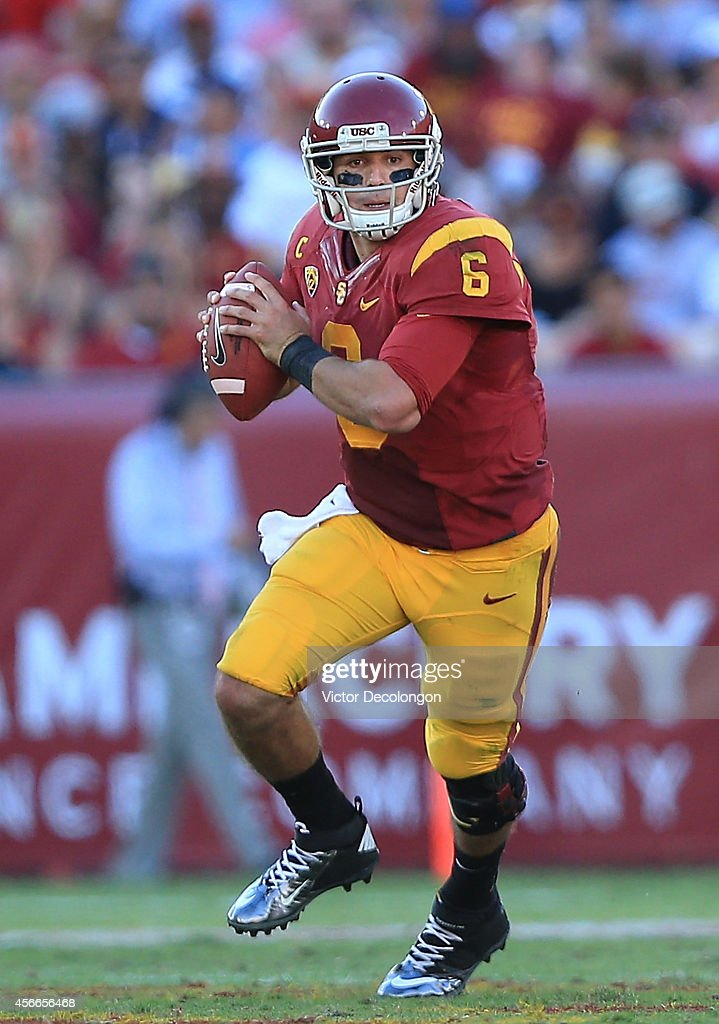 Quarterback <a gi-track='captionPersonalityLinkClicked' href=/galleries/search?phrase=Cody+Kessler&family=editorial&specificpeople=9870723 ng-click='$event.stopPropagation()'>Cody Kessler</a> #6 of the USC Trojans scrambles out of the pocket as he looks to make a pass play in the second quarter against the Arizona State Sun Devils during their game at Los Angeles Memorial Coliseum on October 4, 2014 in Los Angeles, California.