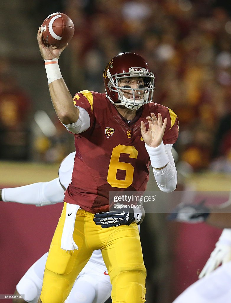 Quarterback Cody Kessler #6 of the USC Trojans throws a pass against the Arizona Wildcats at Los Angeles Coliseum on October 10, 2013 in Los Angeles, California.