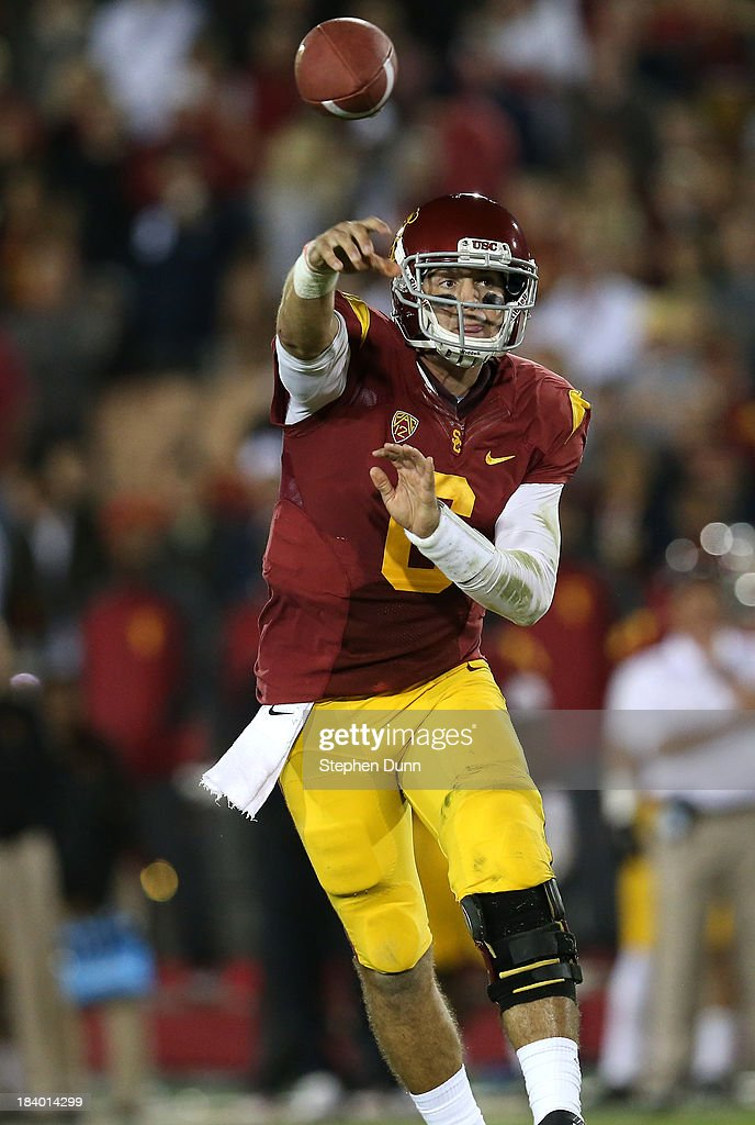 Quarterback Cody Kessler #6 of the USC Trojans throws a pass against the Arizona Wildcats at Los Angeles Coliseum on October 10, 2013 in Los Angeles, California. USC won 38-31.