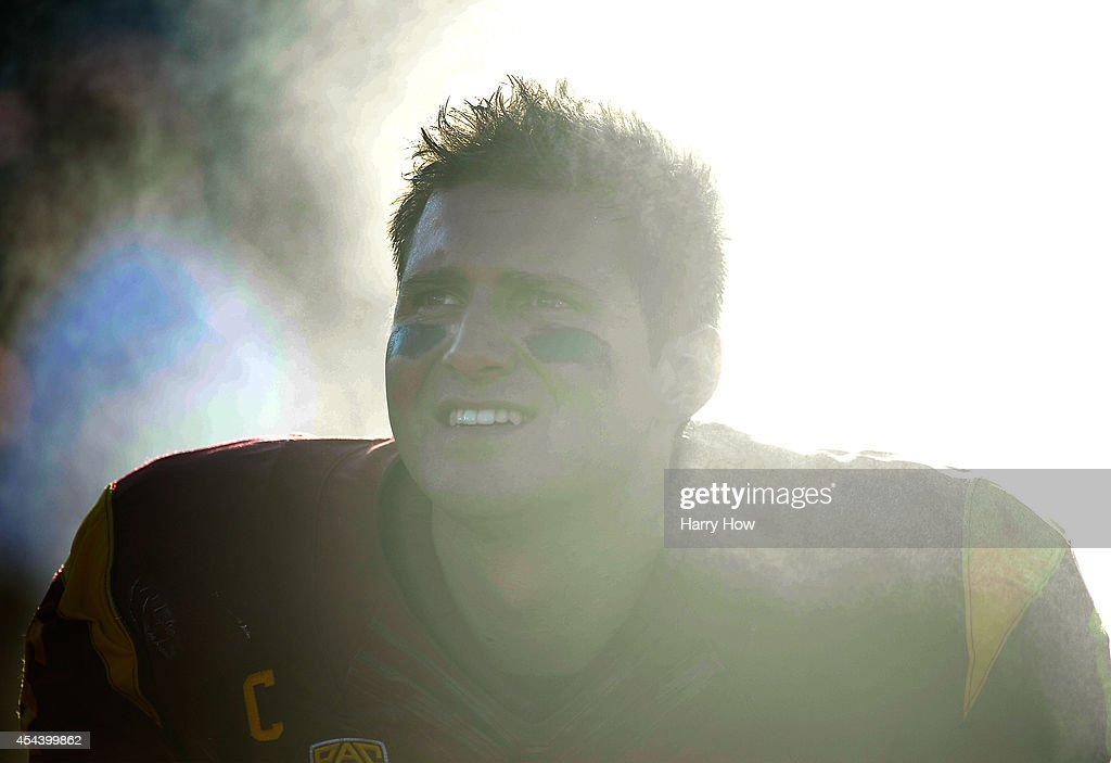 Quarterback <a gi-track='captionPersonalityLinkClicked' href=/galleries/search?phrase=Cody+Kessler&family=editorial&specificpeople=9870723 ng-click='$event.stopPropagation()'>Cody Kessler</a> #6 of the USC Trojans watches from the sidelines with his team leading 31-7 over the Fresno State Bulldogs during the second quarter at Los Angeles Memorial Coliseum on August 30, 2014 in Los Angeles, California.